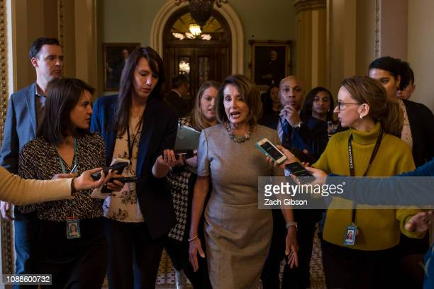House Speaker Nancy Pelosi speaks to reporters as she walks back to her office after a news conference following an announced end to the partial...