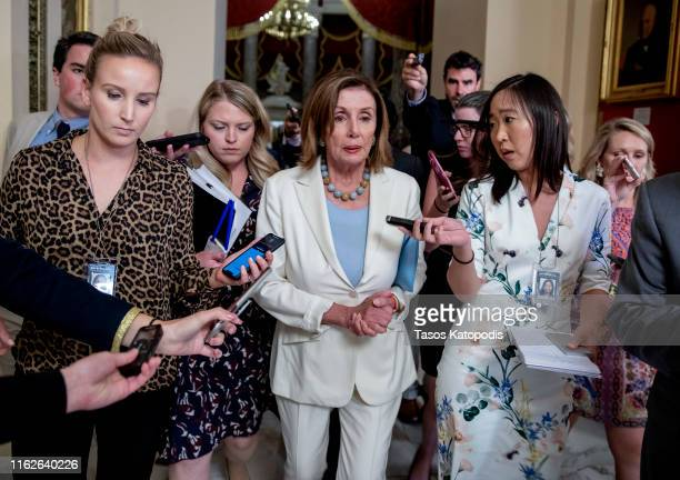 House Speaker Nancy Pelosi speaks to reporters on the way to House Floor on July 17 2019 in Washington DC The House voted to block an effort to...