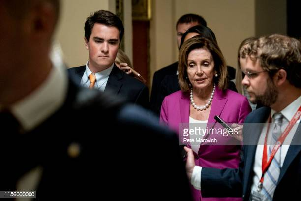 S House Speaker Nancy Pelosi speaks to the members of the media as she makes her way to the House chamber to vote on a resolution denouncing comments...