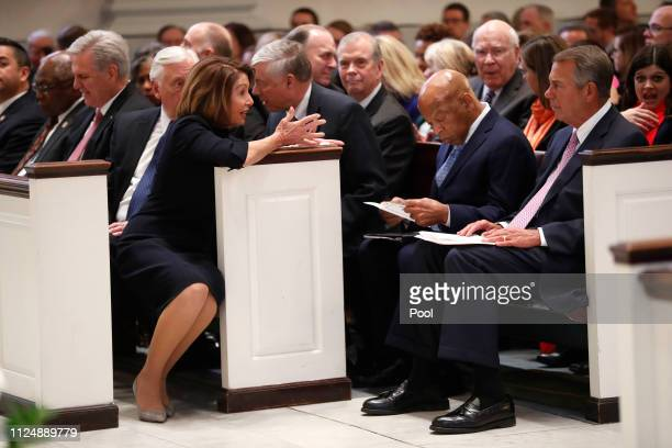 House Speaker Nancy Pelosi talks to former House Speaker John Boehner and Rep John Lewis before a funeral service for former Rep John Dingell on...