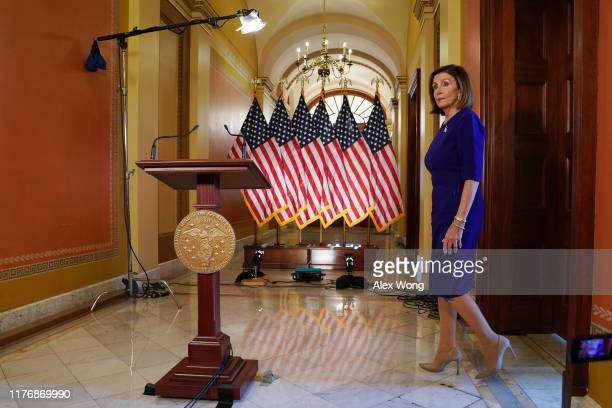 S House Speaker Nancy Pelosi walks towards to a podium to speak to the media at the Capitol Building September 24 2019 in Washington DC Pelosi...