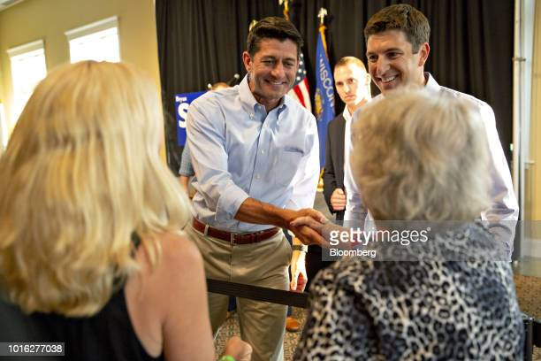 US House Speaker Paul Ryan a Republican from Wisconsin center and Bryan Steil a Republican US Representative candidate from Wisconsin right greet...