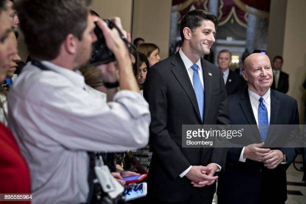 US House Speaker Paul Ryan a Republican from Wisconsin center and Representative Kevin Brady a Republican from Texas and chairman of the House Ways...