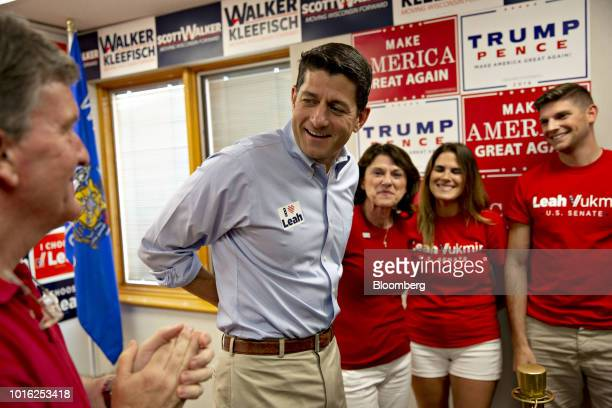 US House Speaker Paul Ryan a Republican from Wisconsin center left arrives for a campaign event with Leah Vukmir a Republican Senate candidate from...