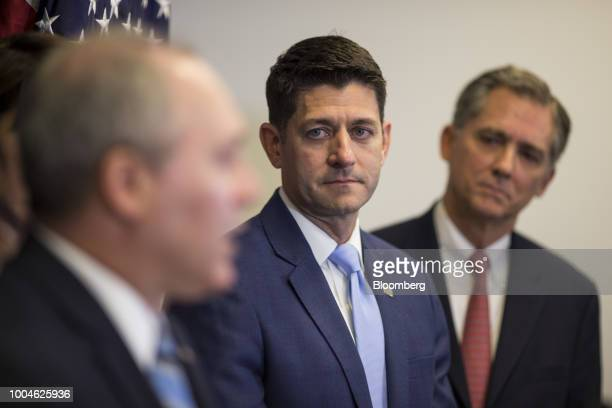 US House Speaker Paul Ryan a Republican from Wisconsin center listens as House Majority Whip Steve Scalise a Republican from Louisiana left speaks...