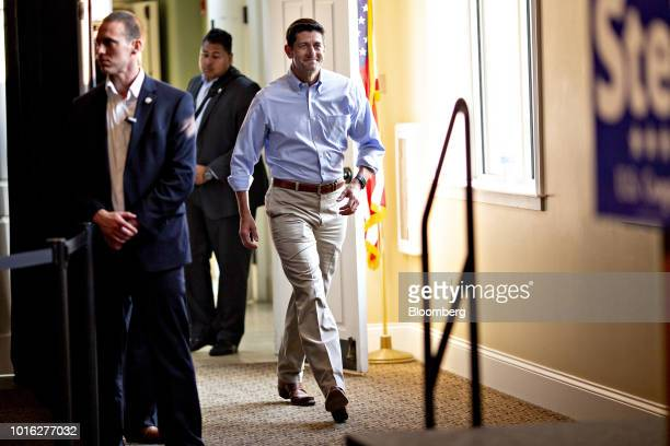 US House Speaker Paul Ryan a Republican from Wisconsin center walks towards the stage during a campaign rally for Bryan Steil a Republican US...