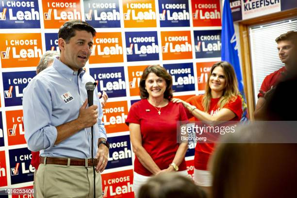 US House Speaker Paul Ryan a Republican from Wisconsin left speaks during a campaign rally for Leah Vukmir a Republican Senate candidate from...
