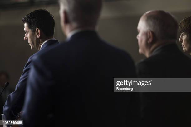 US House Speaker Paul Ryan a Republican from Wisconsin left speaks during a news conference on Capitol Hill in Washington DC US on Thursday Sept 13...