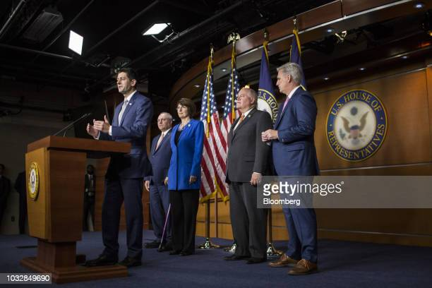 US House Speaker Paul Ryan a Republican from Wisconsin left speaks as House Majority Leader Kevin McCarthy a Republican from California from right...