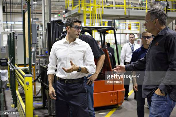US House Speaker Paul Ryan a Republican from Wisconsin left speaks as Matthew 'Matt' Levatich chief executive officer of Harley Davidson Inc looks on...