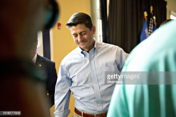 US House Speaker Paul Ryan a Republican from Wisconsin pauses as he greets attendees with Bryan Steil a Republican US Representative candidate from...