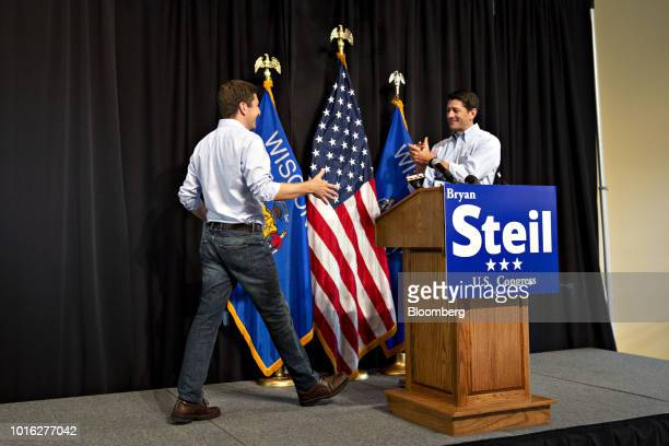 US House Speaker Paul Ryan a Republican from Wisconsin right applauds as Bryan Steil a Republican US Representative candidate from Wisconsin arrives...