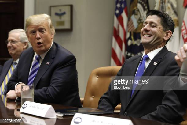 House Speaker Paul Ryan a Republican from Wisconsin right laughs as US President Donald Trump speaks during a meeting with Republican Congressional...