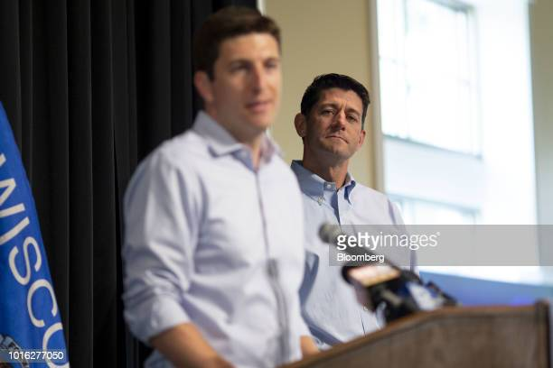 US House Speaker Paul Ryan a Republican from Wisconsin right listens as Bryan Steil a Republican US Representative candidate from Wisconsin speaks...