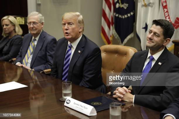 House Speaker Paul Ryan a Republican from Wisconsin right listens as US President Donald Trump speaks during a meeting with Republican Congressional...
