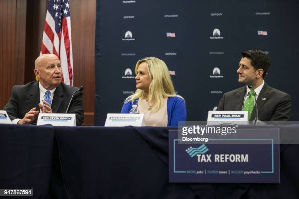 US House Speaker Paul Ryan a Republican from Wisconsin right listens as Representative Kevin Brady a Republican from Texas left speaks during a round...
