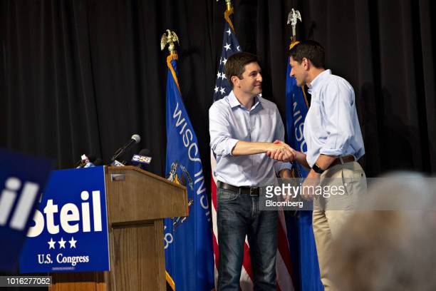US House Speaker Paul Ryan a Republican from Wisconsin right shakes hands with Bryan Steil a Republican US Representative candidate from Wisconsin...