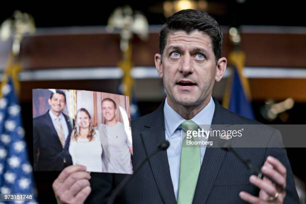 US House Speaker Paul Ryan a Republican from Wisconsin speaks while holding a photograph of constituents affected by opioid abuse during a news...