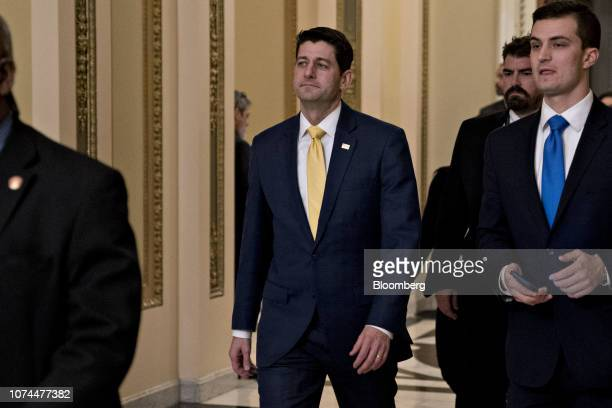 House Speaker Paul Ryan, a Republican from Wisconsin, walks though the U.S. Capitol after voting on the House floor in Washington, D.C., U.S., on...