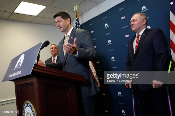 S House Speaker Paul Ryan accompanied by Reps Steve Scalise and Kevin McCarthy talks with journalists during a news conference following a House...