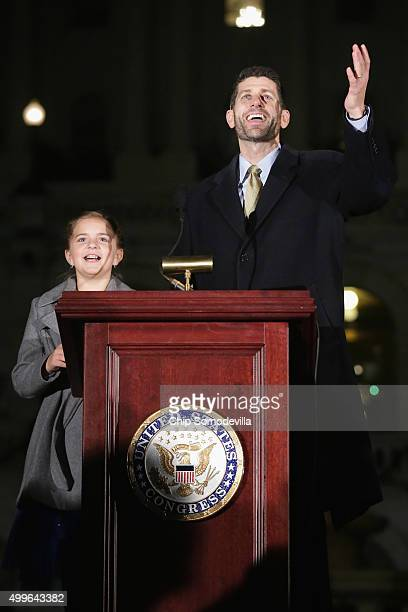 House Speaker Paul Ryan and fifthgrader Anna DeVolld of Soldotna Alaska light the Capitol Christmas tree on the west front of the US Capitol December...