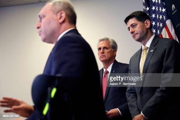 S House Speaker Paul Ryan and House Majority Leader Rep Kevin McCarthy look on as Majority Whip Rep Steve Scalise speaks with reporters during a news...