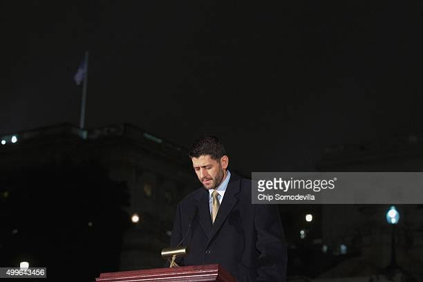 House Speaker Paul Ryan bows his head after calling for a moment of silence for the victims of the mass murder in San Bernadino, California, during...