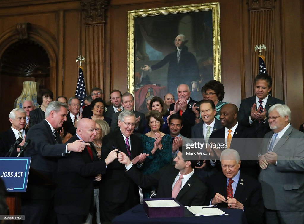 House And Senate Leaders Gather For Tax Bill Enrollment Ceremony : News Photo