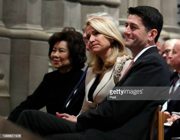 House Speaker Paul Ryan, his wife Janna Ryan, Transportation Secretary Elaine Chao, and Senate Majority Leader Mitch McConnell listen during the...