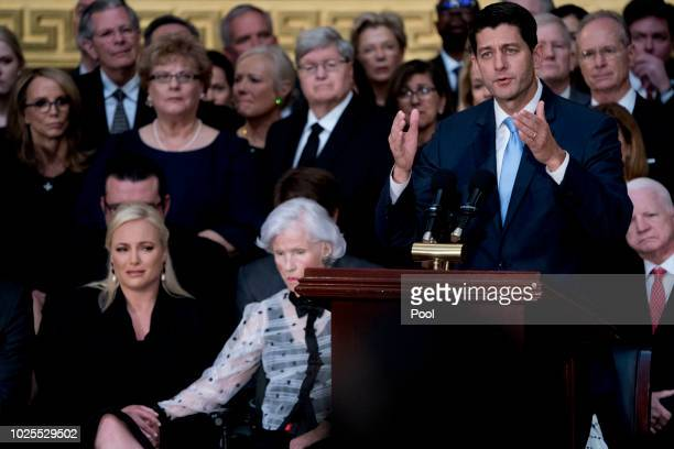 House Speaker Paul Ryan of Wis., right, accompanied by McCain's daughter Meghan McCain, and McCain's mother Roberta McCain, second from left, speaks...