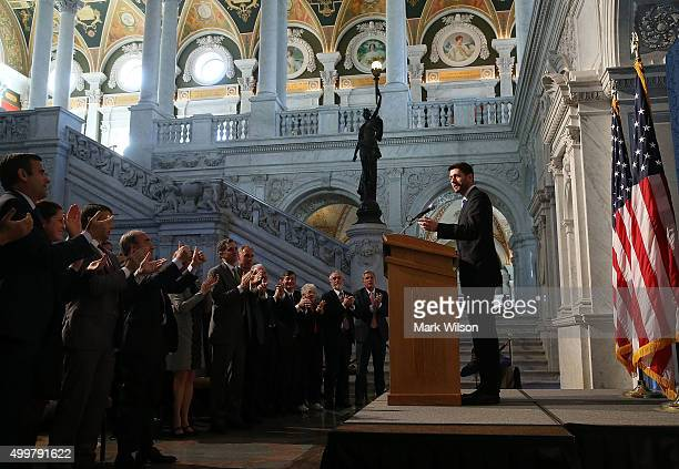 House Speaker Paul Ryan receives applause from members of Congress listening to his speech at the Library of Congress December 3 2015 in Washington...