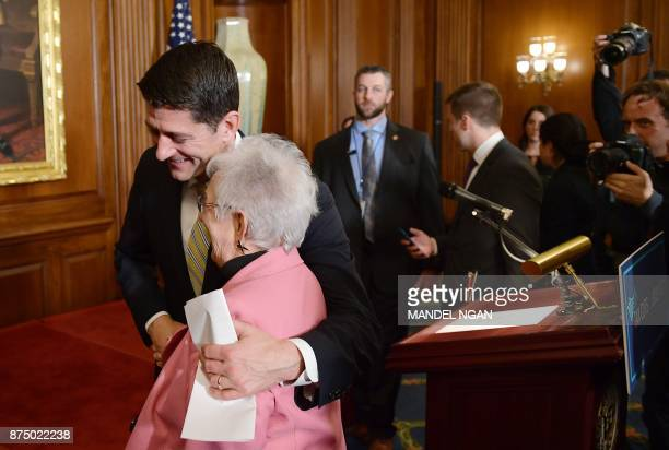 House Speaker Paul Ryan RWI hugs Rep Virginia Foxx RNC following a press conference after the House passed its version of the Republican tax overhaul...