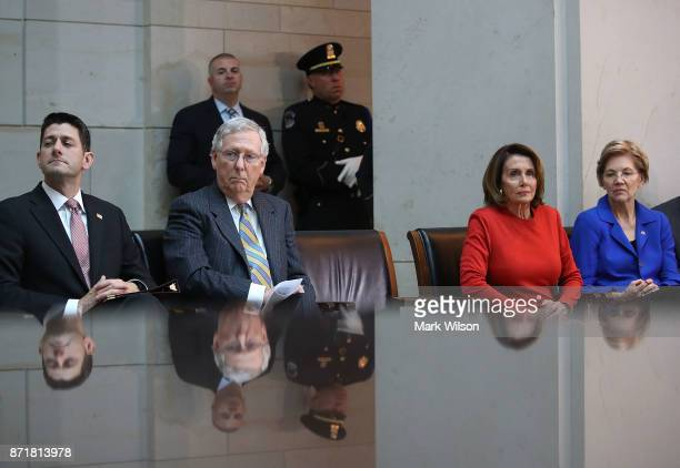 House Speaker Paul Ryan Senate Majority Leader Mitch McConnell House Minority Leader Nancy Pelosi Sen Elizabeth Warren participate in a ceremony to...