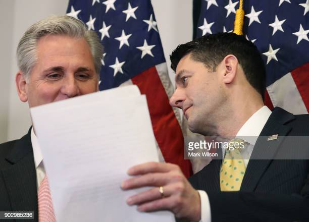 House Speaker Paul Ryan shows a paper to House Majority Leader Kevin McCarthy while speaking to the media about the GOP agenda after a meeting with...