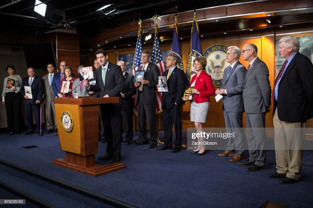 U.S. House Speaker Paul Ryan (R-WI) speaks as photographs are held up of people affected by the opioid epidemic during a news conference following a Republican Conference meeting on Capitol Hill on June 13, 2018 in Washington, DC.