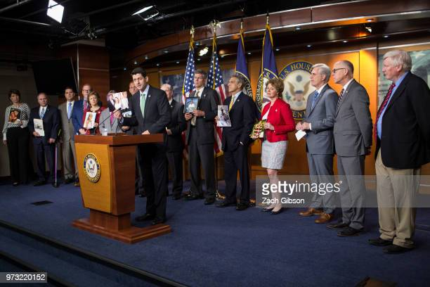 S House Speaker Paul Ryan speaks as photographs are held up of people affected by the opioid epidemic during a news conference following a Republican...