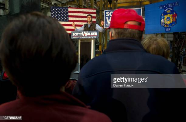 House Speaker Paul Ryan speaks at a rally held by Governor Scott Walker for a last minute get out the vote event the night before the midterm...