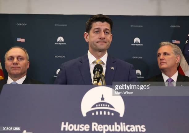 House Speaker Paul Ryan speaks to the media while flanked by House Majority Leader Kevin McCarthy and House Majority Whip Steve Scalise after a...