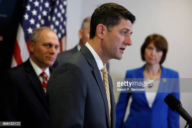 House Speaker Paul Ryan talks with journalists during a news conference following a House Republican Conference meeting June 6 2018 on Capitol Hill...