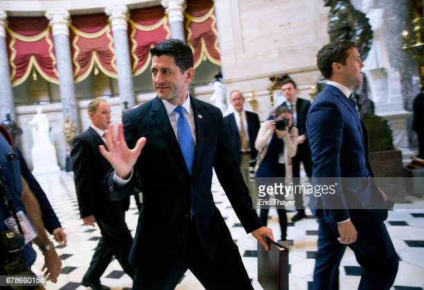 House Speaker Paul Ryan walks in to the House chamber to vote on Capitol Hill May 4 2017 in Washington DC The House voted to pass the GOPs healthcare...