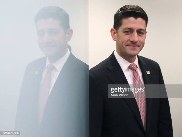 House Speaker Paul Ryan walks into a media briefing after attending a closed House Republican conference on Capitol Hill on March 28 2017 in...