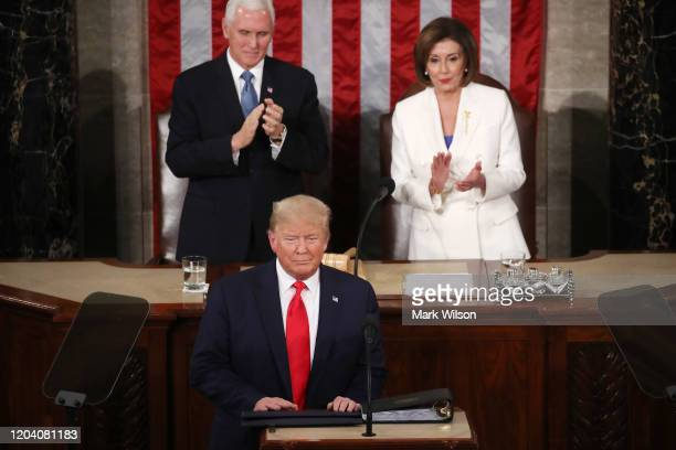 House Speaker Rep. Nancy Pelosi and Vice President Mike Pence applaud as President Donald Trump steps to the lectern for the State of the Union...