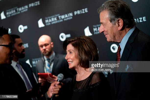 US House Speaker Representative Nancy Pelosi and her husband Paul Pelosi arrive at the Kennedy Center for the Mark Twain Award for American Humour on...