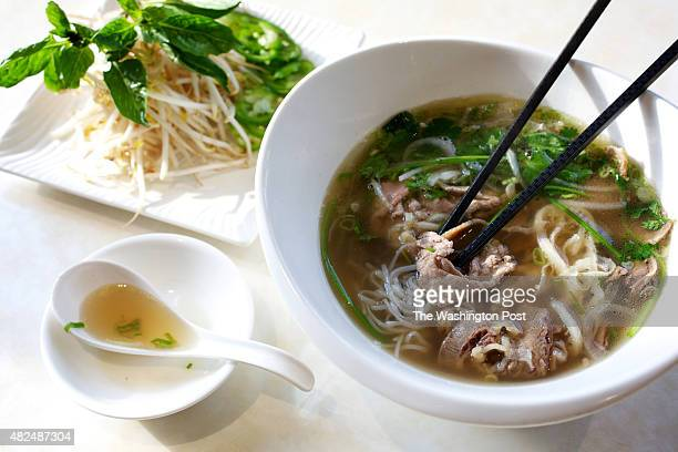 WHEATON MD House special Pho with slides of well done brisket fatty brisket well done flank tendon bible tripe and sliced eye of round steak at Cam...