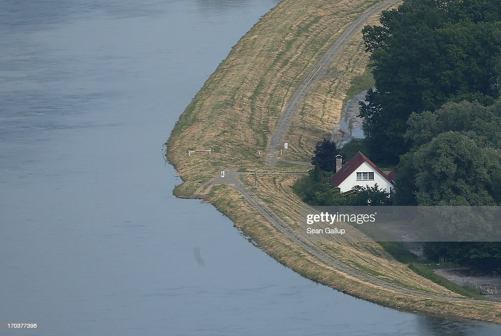 A house stands next to a dyke protecting it from the flooding Elbe river on June 12, 2013 near Wittenberge, Germany. The swollen Elbe is continuing to endanger communities along its northern route in Saxony-Anhalt and Brandenburg states, though the bursting of a dyke near Fischbeck has relieved some pressure from towns farther north. Floods have ravaged portions of southern and eastern Germany in the last week, leaving at least eight people dead and forcing tens of thousands to evacuate their homes.