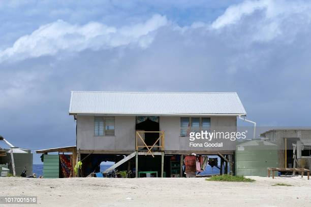 A house stands on reclaimed land next to the ocean on August 15 2018 in Funafuti Tuvalu 'Borrow pits' created by the US military to build an airstrip...
