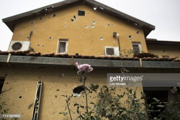A house that was damaged by a rocket strike from the Gaza Strip on May 6 2019 in Ashkelon Israel Palestinian leaders in Gaza agreed a ceasefire with...