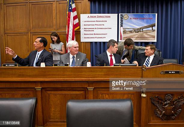 House Transportation Chairman John L Mica RFla far right talking with aides before a news conference introducing the Republican transportation...