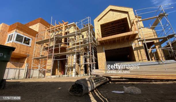 A house under construction is seen in Culver City a neighborhood of Los Angeles on November 21 2020 The US real estate market is booming even as the...
