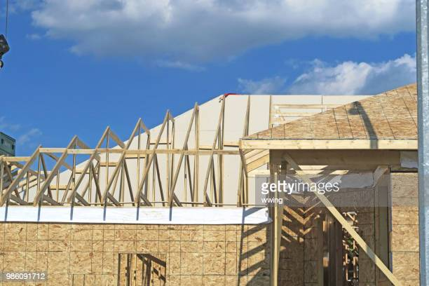 house under construction with roof currently worked on. - herpes zoster foto e immagini stock